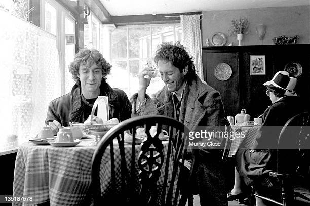 British actors Paul McGann and Richard E Grant film a scene in Stony Stratford Buckinghamshire for the movie 'Withnail I' 1986 The cafe is doubling...