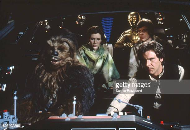 British actors Peter Mayhew Anthony Daniels American Carrie Fisher and Harrison Ford on the set of Star Wars Episode VI Return of the Jedi directed...