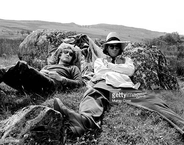 British actors Richard E Grant and Paul McGann relaxing in Cumbria on the set of the movie 'Withnail I' 1986