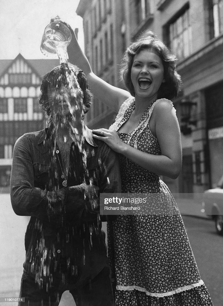 British actors Richard O'Sullivan and Fiona Fullerton who are co-starring in the pantomime 'Cinderella' at the London Palladium, pose outside the theatre on Argyll Street, London, 1977.