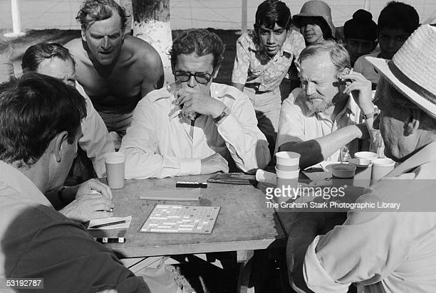 British actors Roger Moore and Trevor Howard relax with a game of Scrabble on the set of 'The Sea Wolves The Last Charge of the Calcutta Light Horse'...