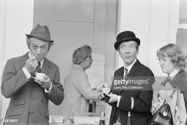 British actors Sid James and Kenneth Williams eating jellied eels from paper cups during the filming of 'Carry On At Your Convenience' 1971 Actress...