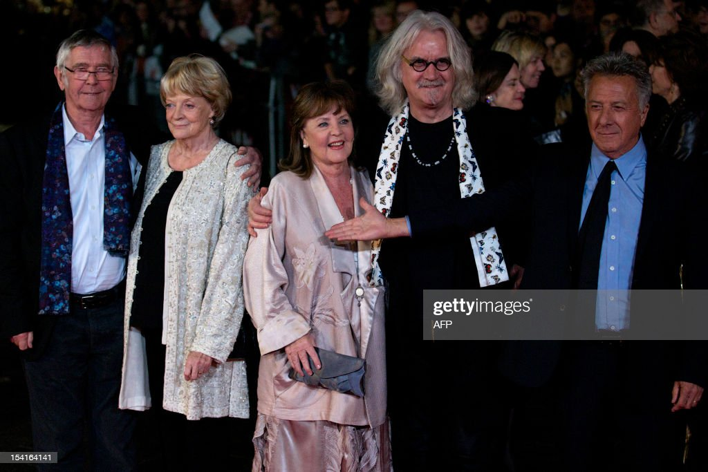 British actors Tom Courtenay, Maggie Smith, Pauline Collins, Billy Connolly and US actor and director Dustin Hoffman pose on the red carpet as they arrive to attend the premiere of their film 'Quartet' during the 56th BFI London Film Festival in London on October 15, 2012. Quartet, directed by Dustin Hoffman stars Maggie Smith, Michael Gambon and Scottish comedian Billy Connolly among others.