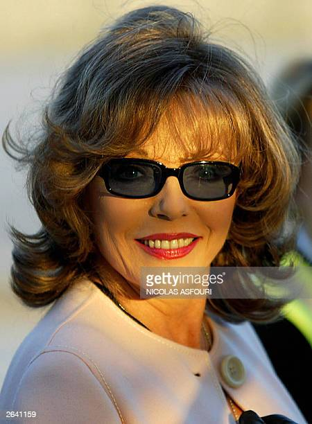 British actres Joan Collins comes down of the Concorde last flight from New York BA 002 at Heathrow international airport in London 24 October 2003...