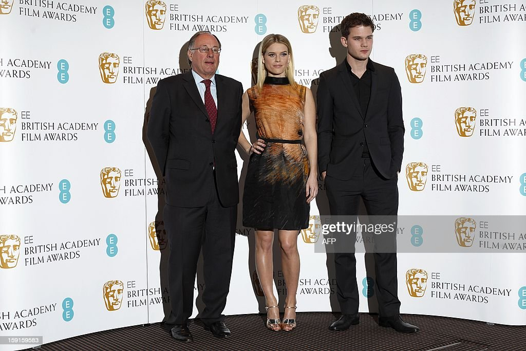 British actress Alice Eve (C) and British actor Jeremy Irvine (R) pose for pictures with BAFTA (British Academy of Film and Television Awards) Chairman John Willis (L) at a photocall to mark the 2013 BAFTA nominations in central London, on January 9, 2013. Steven Spielberg's political drama 'Lincoln', the film version of hit stage musical 'Les Miserables' and Ang Lee's 'Life of Pi' lead the nominations for the BAFTAs announced in London. All three are in the running for best film in the British awards, viewed as one of the indicators of Oscars glory, alongside Kathryn Bigelow's Osama bin Laden manhunt movie 'Zero Dark Thirty' and Iran hostage drama 'Argo'. AFP PHOTO / JUSTIN TALLIS