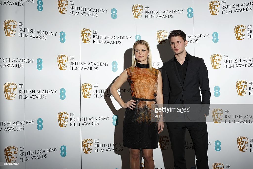 British actress Alice Eve (L) and British actor Jeremy Irvine (R) pose for pictures at a photocall to mark the 2013 BAFTA (British Academy of Film and Television Awards) nominations in central London, on January 9, 2013. Steven Spielberg's political drama 'Lincoln', the film version of hit stage musical 'Les Miserables' and Ang Lee's 'Life of Pi' lead the nominations for the BAFTAs announced in London. All three are in the running for best film in the British awards, viewed as one of the indicators of Oscars glory, alongside Kathryn Bigelow's Osama bin Laden manhunt movie 'Zero Dark Thirty' and Iran hostage drama 'Argo'.