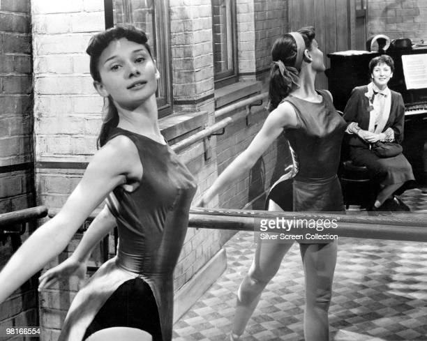 British actress and dancer Audrey Hepburn rehearsing at the barre circa 1950