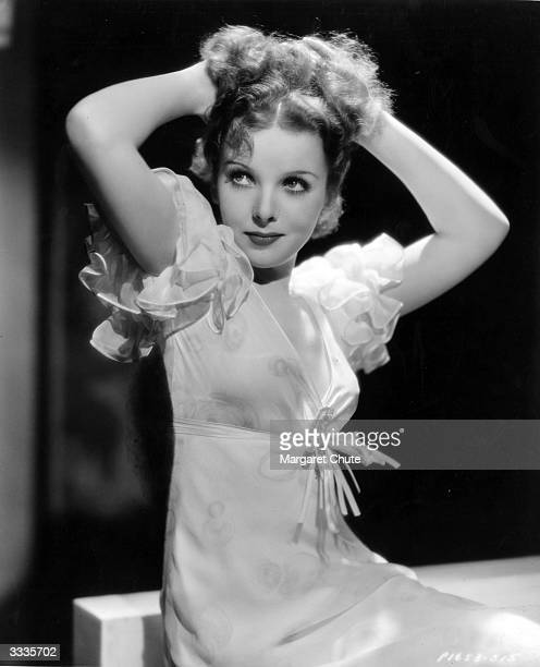British actress and future film director Ida Lupino wearing a silk negligee