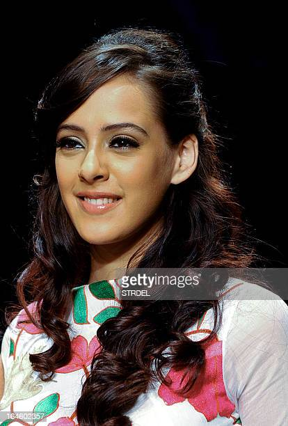 British actress and model Hazel Keech showcases a creation by designer Purvi Doshi during a show on the fourth day of Lakme Fashion Week...