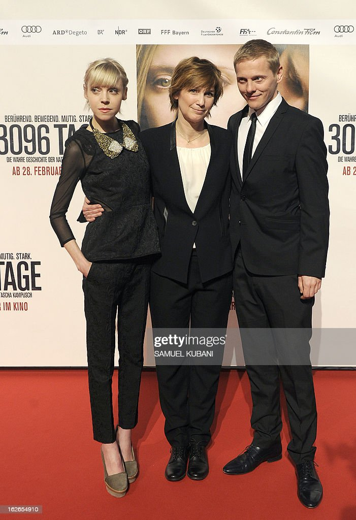 British actress Antonia Campbell-Hughes, German director Sherry Hormann and Danish actor Thure Lindhardt pose for photographers as they arrive for the premiere of the film '3,096 Days' based on the story of Austrian kidnap victim Natascha Kampusch on February 25, 2013 in Vienna. AFP PHOTO/SAMUEL KUBANI