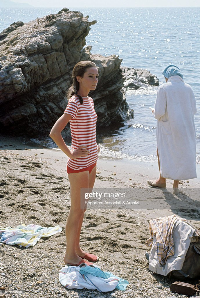 http://media.gettyimages.com/photos/british-actress-audrey-hepburn-on-the-beach-during-a-pause-on-the-set-picture-id487830546