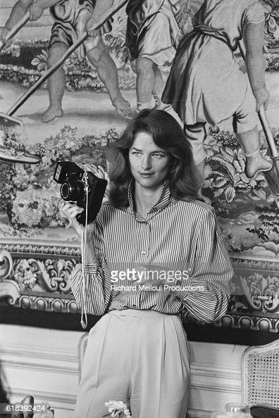British actress Charlotte Rampling photographer during a men's fashion show for the Vogue magazine