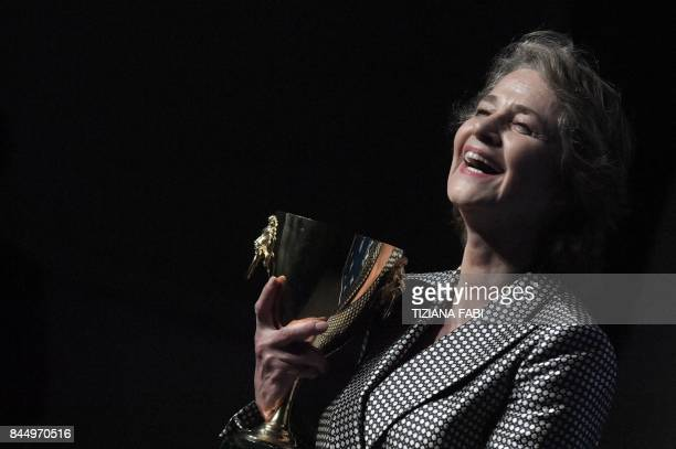 TOPSHOT British actress Charlotte Rampling poses during a photcall after she receives the Coppa Volpi for Best Actress for her character in the movie...