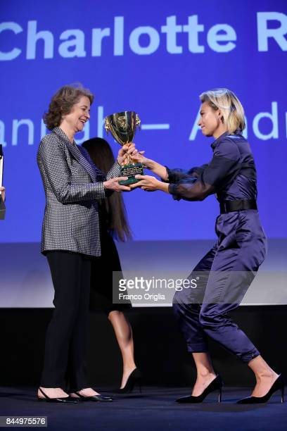 British actress Charlotte Rampling receives the Coppa Volpi for Best Actress for her character in the movie 'Hannah' from the hands of Italian...