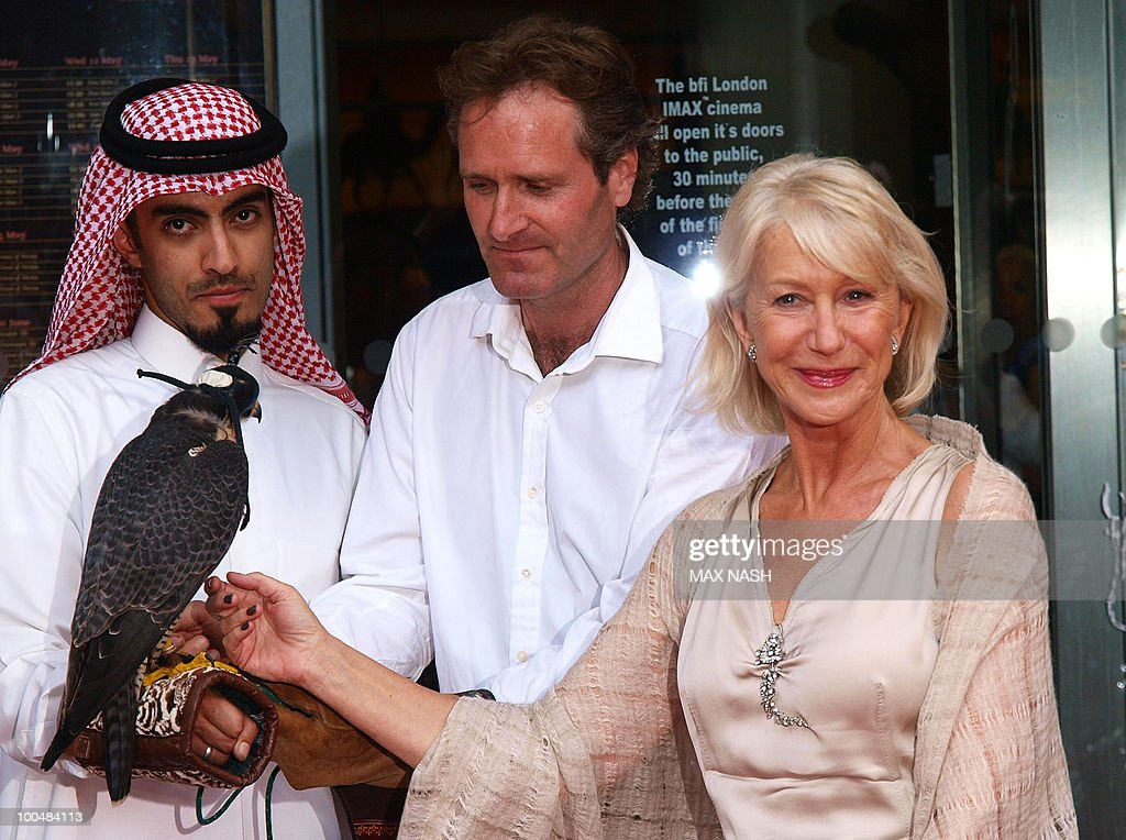 British actress Dame Helene Mirren (R), flanked by unidentified persons, arrives to attend The Royal Premiere of Arabia 3D in London's South Bank, on May 24, 2010.