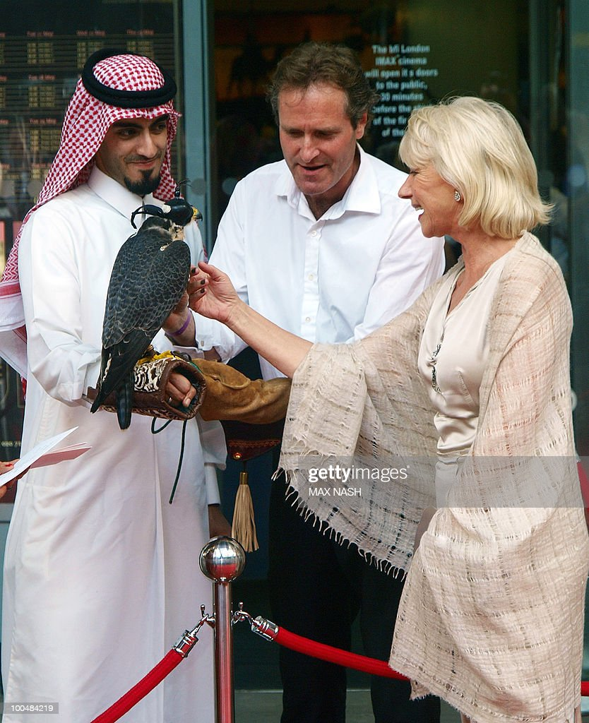 British actress Dame Helene Mirren strokes a falcon as she arrives to attend the Royal Premiere of Arabia 3D in London's South Bank, on May 24, 2010. AFP Photo/MAX