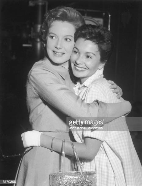British actress Deborah Kerr hugging her fellow star Jean Simmons on the set of her latest film 'Tea and Sympathy'