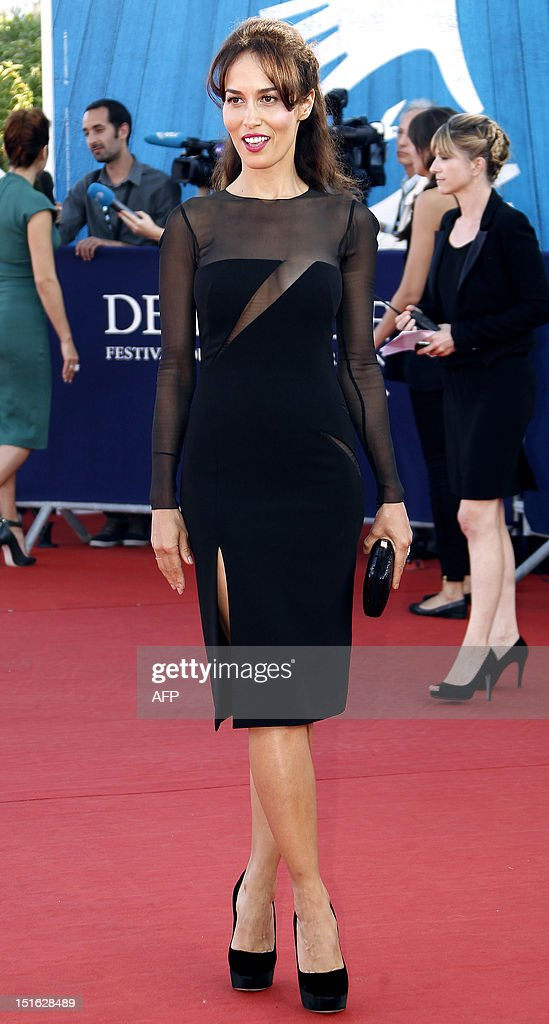 British actress Dolores Chaplin poses on the red carpet as she arrives to attend the awarding ceremony off the 38th Deauville's US Film Festival on September 8, 2012 in the French northwestern sea resort of Deauville.