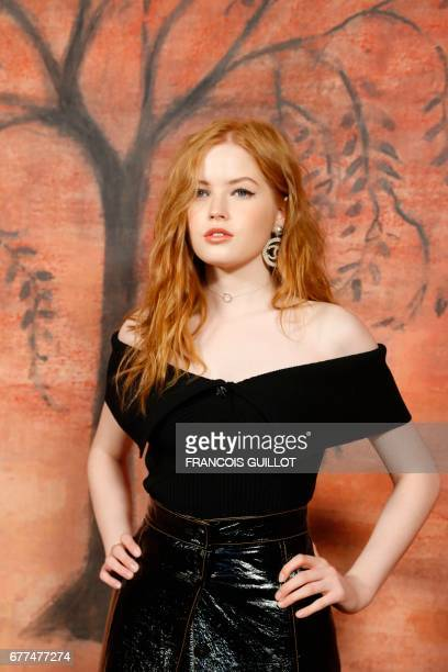 British actress Ellie Bamber poses during the photocall before the Chanel Croisiere fashion show on May 3 2017 at the Grand Palais in Paris / AFP...