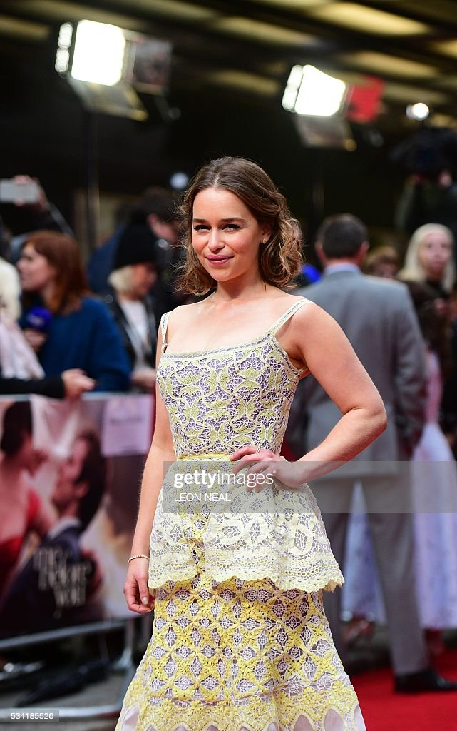 British actress Emilia Clarke poses for pictures as she arrives for the European Premiere of the film 'Me Before You' in central London, on May 25, 2016. / AFP / LEON