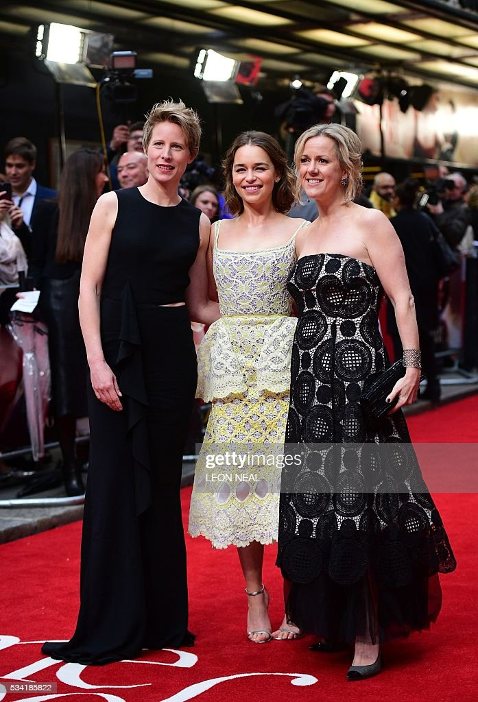 British actress Emilia Clarke (C) poses for pictures with author Jojo Moyes (R) and director Thea Sharrock (L) as they arrive for the European Premiere of the film 'Me Before You' in central London, on May 25, 2016. / AFP / LEON