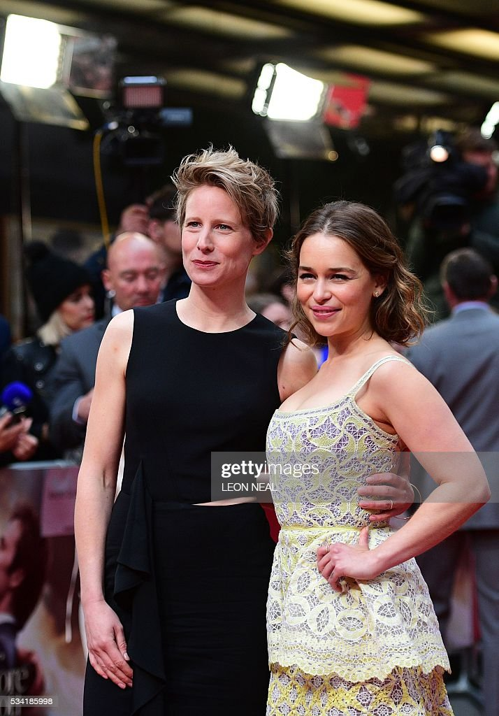 British actress Emilia Clarke (R) poses for pictures with director Thea Sharrock as they arrive for the European Premiere of the film 'Me Before You' in central London, on May 25, 2016. / AFP / LEON