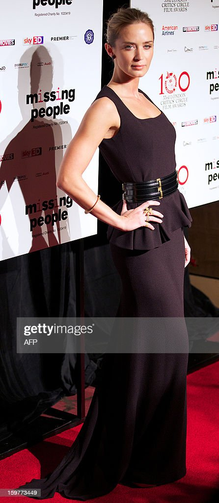 British actress Emily Blunt poses for pictures on the red carpet as she arrives for the 33rd London Critics Circle Film Awards in central London on January 20, 2013.