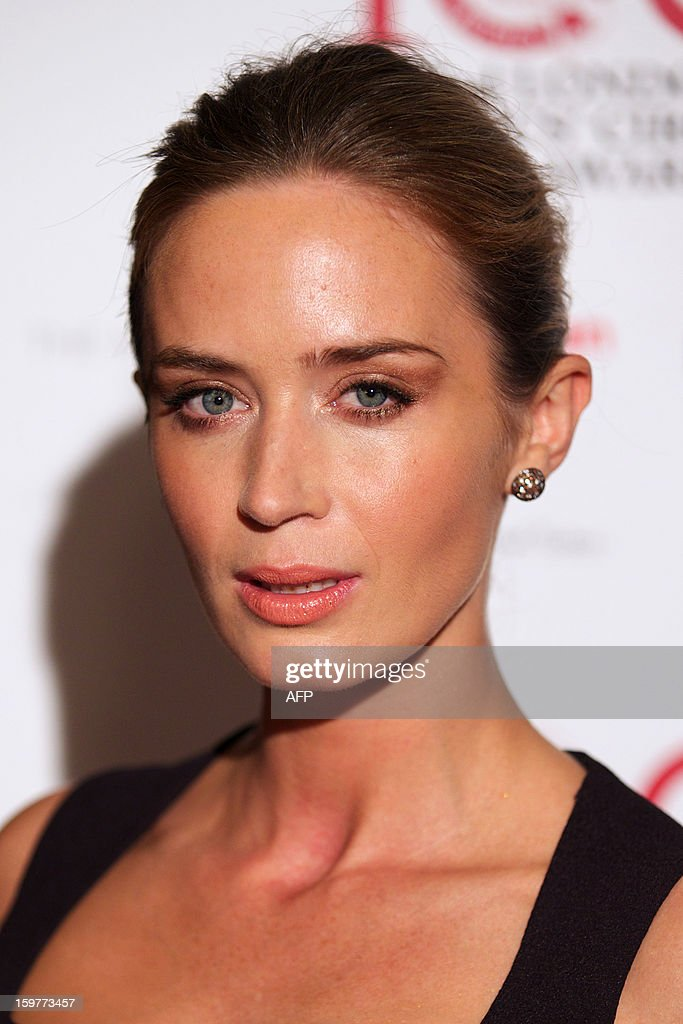 British actress Emily Blunt poses for pictures on the red carpet as she arrives for the 33rd London Critics Circle Film Awards in central London on January 20, 2013. AFP PHOTO/ANDREW COWIE