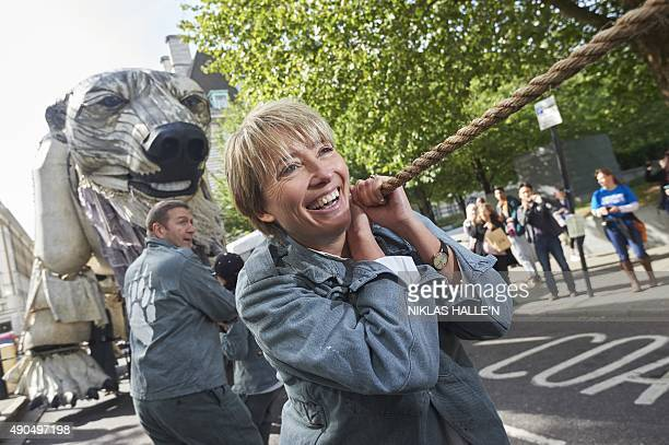 British actress Emma Thompson helps to tow away the giant polar bear which has been in place outside the Shell building for weeks during a...