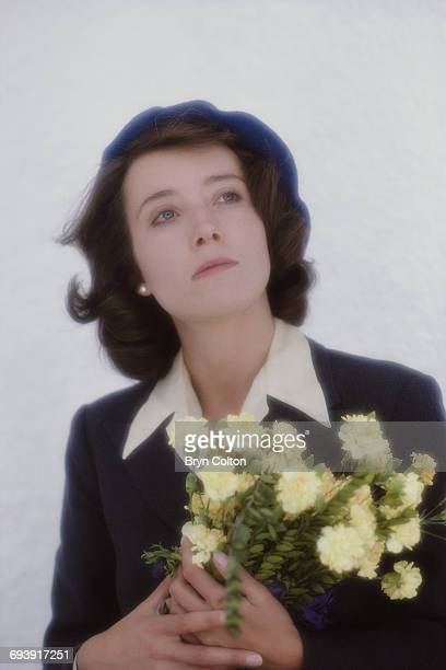 British actress Emma Thompson playing the role of Harriet Pringle holds a bouquet of flowers photographed during the filming of the new BBC drama...