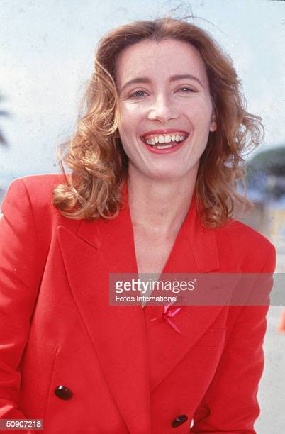 British actress Emma Thompson smiles in a red suit while arriving at the Independent Spirit Awards 1990s