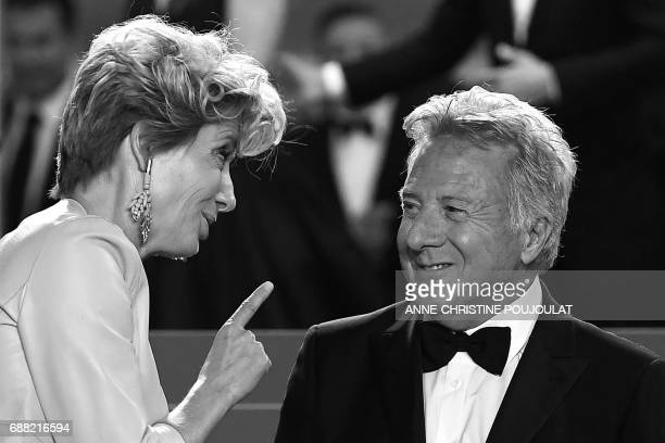 British actress Emma Thompson talks with US actor Dustin Hoffman as they leave the Festival Palace on May 21 2017 following the screening of the film...