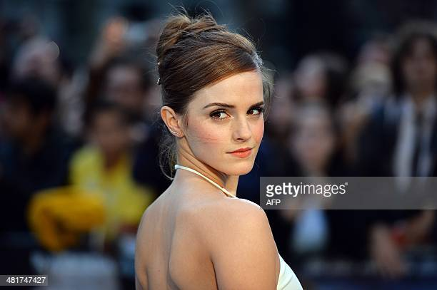 British actress Emma Watson poses for pictures on the red carpet as she arrive for the UK premiere of her latest film 'Noah' in Leicester Square...