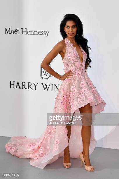 British actress Fagun Thakrar poses as she arrives for the amfAR's 24th Cinema Against AIDS Gala on May 25 2017 at the Hotel du CapEdenRoc in Cap...