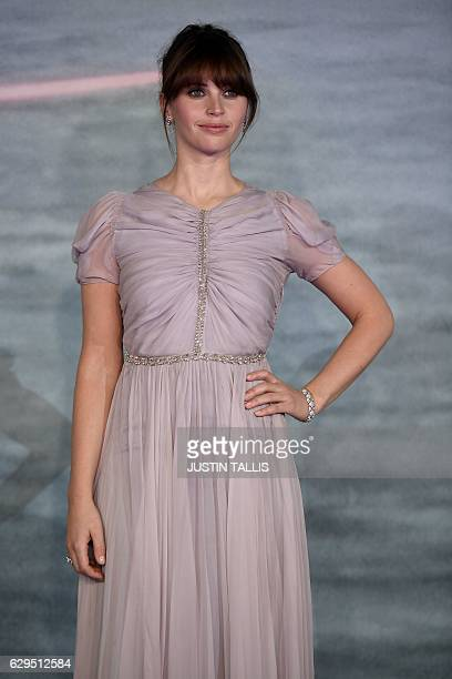 British actress Felicity Jones poses on the red carpet upon arrival at the UK launch event of Lucasfilm's 'Rogue One A Star Wars Story' at the Tate...
