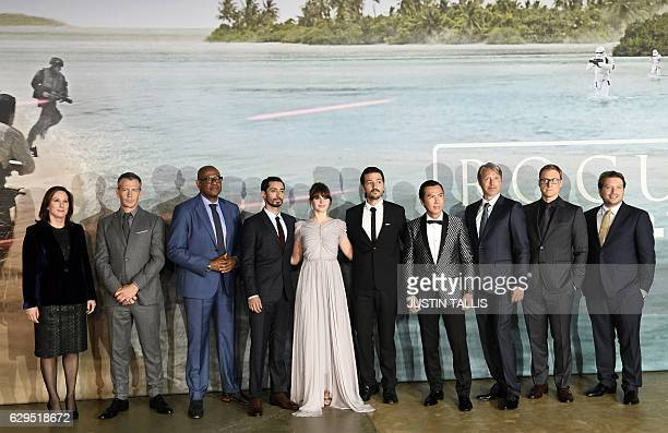 British actress Felicity Jones poses with cast members upon arrival at the UK launch event of Lucasfilm's 'Rogue One A Star Wars Story' at the Tate...