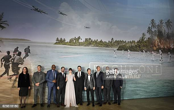 British actress Felicity Jones poses with cast memebers upon arrival at the UK launch event of Lucasfilm's 'Rogue One A Star Wars Story' at the Tate...