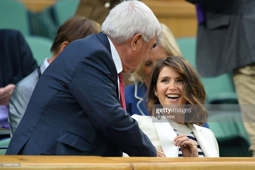 British actress Gemma Arterton (R) meets Robbie Federer (L), father of Switzerland's Roger Federer, in the royal box to watch Poland's Agnieszka Radwanska play against Ukraine's Kateryna Kozlova during their women's singles first round match on the third day of the 2016 Wimbledon Championships at The All England Lawn Tennis Club in Wimbledon, southwest London, on June 29, 2016. / AFP / GLYN