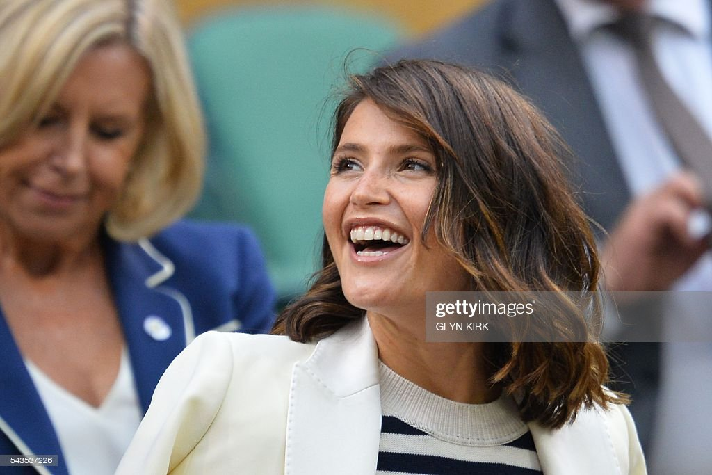 British actress Gemma Arterton takes her seat in the royal box to watch Poland's Agnieszka Radwanska play against Ukraine's Kateryna Kozlova during their women's singles first round match on the third day of the 2016 Wimbledon Championships at The All England Lawn Tennis Club in Wimbledon, southwest London, on June 29, 2016. / AFP / GLYN