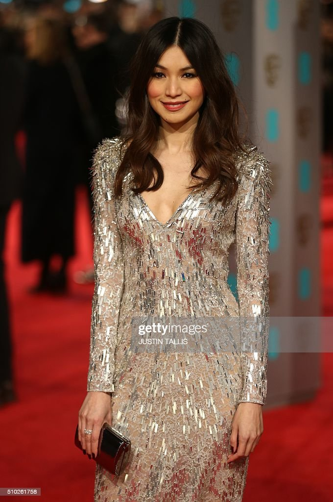 British actress Gemma Chan poses on arrival for the BAFTA British Academy Film Awards at the Royal Opera House in London on February 14, 2016. TALLIS