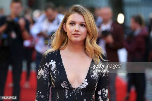 British actress Hannah Murray poses for a photograph upon arrival at the European premiere of 'Detroit' in London on August 16 2017 / AFP PHOTO /...
