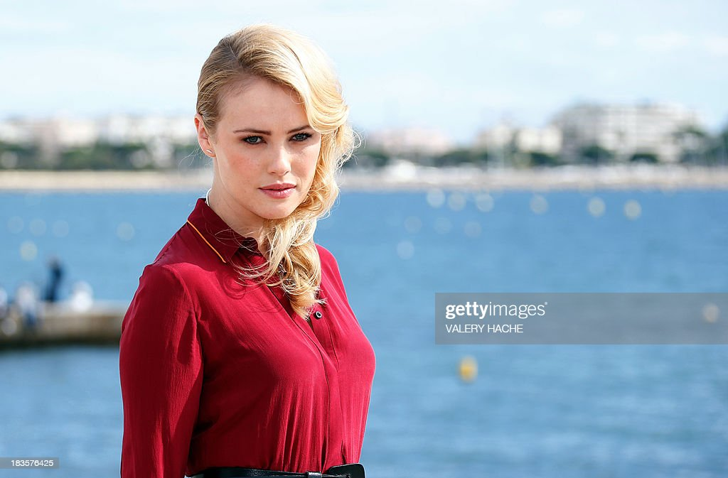 British actress Hannah New poses during a photocall for the TV series 'Black Sails' as part of the Mipcom international audiovisual trade show at the Palais des Festivals, in Cannes, southeastern France, on October 7, 2013. AFP PHOTO / VALERY HACHE