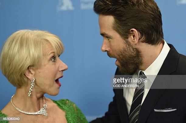 British actress Helen Mirren and Canadian actor Ryan Reynolds pose for photographers during a photocall for the film 'Woman in Gold' presented as...