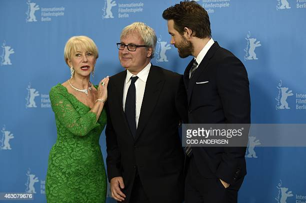 British actress Helen Mirren director Simon Curtis and Canadian actor Ryan Reynolds pose for photographers during a photocall for the film 'Woman in...