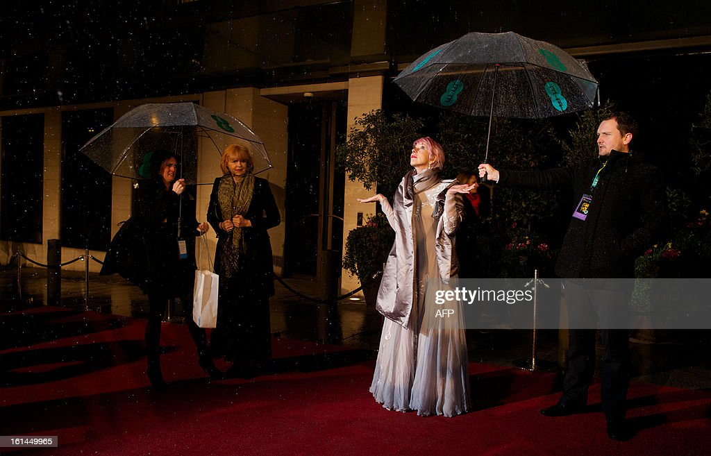 British actress Helen Mirren poses as she arrives for the BAFTA British Academy Film Awards after party in London on February 10, 2013.