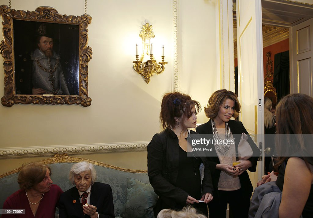British actress Helena Bonham Carter (C) and Broadcaster Natasha Kaplinsky (2nd R) speak with guests during a reception for survivors of the Holocaust to commemorate International Holocaust Remembrance Day at 10 Downing Street on January 27, 2014, in London, England. British Prime Minister David Cameron has announced that actress Helena Bonham Carter, broadcaster Natasha Kaplinsky, chief rabbi Ephraim Mirvis and a selection of politicians and businessmen will sit on the Holocaust Commission, which will discuss ways to ensure future generations will not forget the events of the Holocaust.