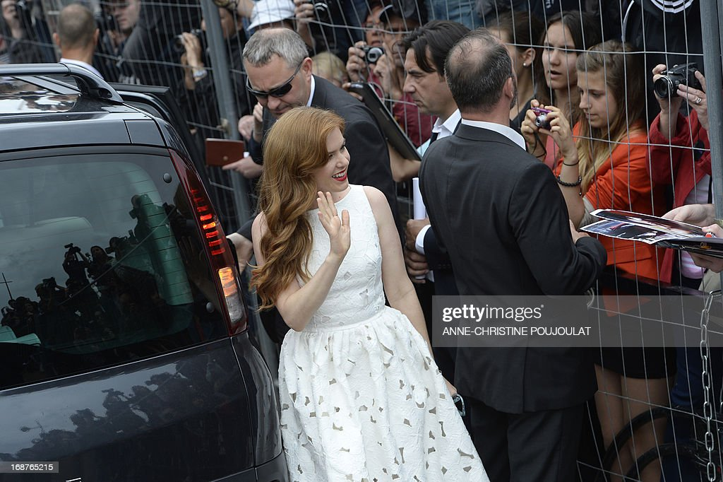 British actress Isla Fisher waves as she arrives on May 15, 2013 to attend a photocall for 'The Great Gatsby' ahead of the opening of the 66th edition of the Cannes Film Festival on May 15, 2013 in Cannes. Cannes, one of the world's top film festivals, opens on May 15 and will climax on May 26 with awards selected by a jury headed this year by Hollywood legend Steven Spielberg.