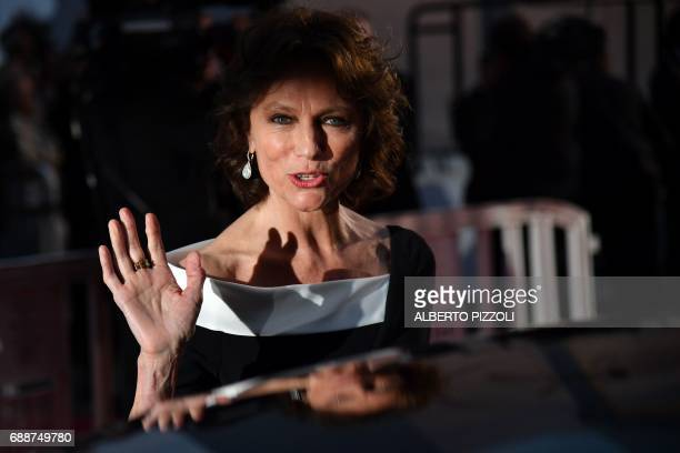 British actress Jacqueline Bisset waves as she gets into a car on May 26 2017 following the screening of the film 'L'Amant Double' at the 70th...