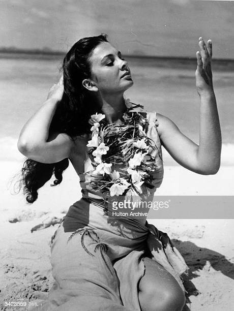British actress Jean Simmons wearing a garland of flowers in a scene from the film 'The Blue Lagoon' directed by Frank Launder for Individual