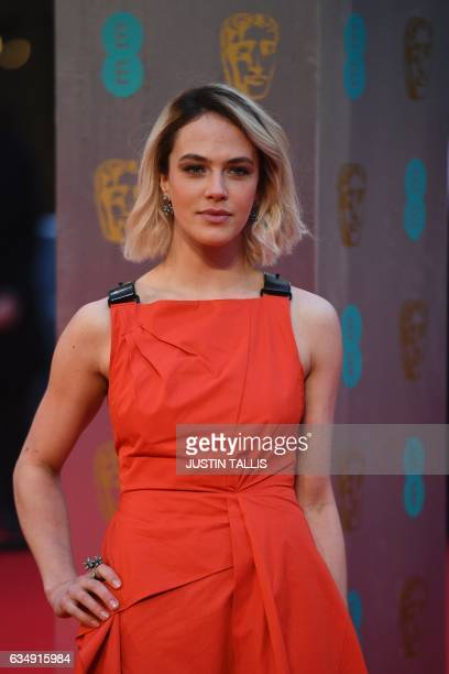 British actress Jessica Brown Findlay poses upon arrival at the BAFTA British Academy Film Awards at the Royal Albert Hall in London on February 12...